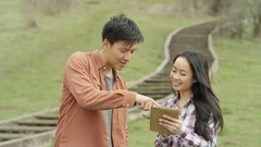 4K Happy young Asian family spending time outdoors in the countryside Stock Footage