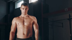 Muscular handsome man standing in large gym Stock Footage