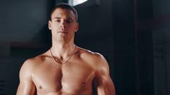 Muscular man posing topless Stock Footage
