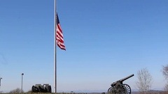 Scenic US Flag Waving over Artillery Canon and Beautiful Background Stock Footage
