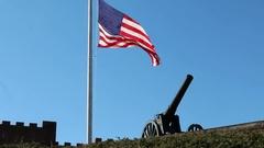 American Flag Waving over Artillery Canon Stock Footage