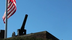 Isolated Shot of Historic Artillery Canon with Waving US Flag Stock Footage
