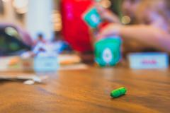 Green color pastel crayon on brown wooden table Stock Photos