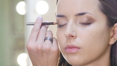 Eye makeup woman applying eyeshadow powder Stock Footage