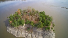 Fly over Tower Rock in the mighty Mississippi River Stock Footage