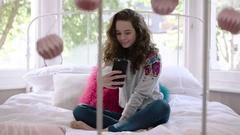 Teenager posing for selfie in bedroom Arkistovideo