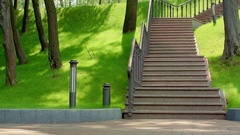 Granite stairs in park. Staircase in green park. Stone stairs in city park Stock Footage