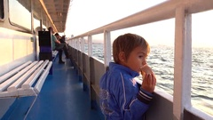 Small child watches the sea from aboard Stock Footage