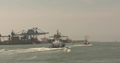Tug boat sets sail from homebase towards North Sea Stock Footage