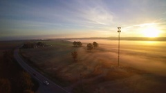 Jib shot with cell phone tower and sunrise in background Stock Footage