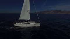 White sailboat in the sea. Closeup. Aerial view. Stock Footage