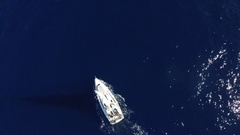 Flying over white sailboat in the ocean. Aerial view. Stock Footage