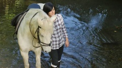 Young woman with a white horse riding Stock Footage