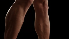 Healthy young man showing his leg's muscles Stock Footage