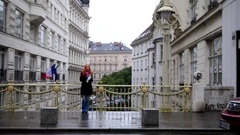 Young red hair woman using city map in Vienna, wide angle Stock Footage
