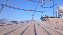 Low ground view of wooden boat deck on a sunny day Stock Footage