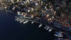Harbour on the island of Symi. Several ships are at berth. Aerial view. Stock Footage