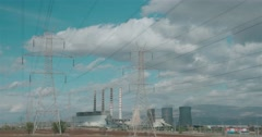 Beautiful clouds over power pole and factory chimneys Stock Footage