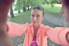 Women taking selfies after fitness exercises in the park. Kuvituskuvat