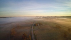 Aerial over a road with low level fog conditions - Southern Illinois Stock Footage