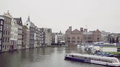 Amsterdam, Netherlands, Tour boat sails in canal, Holland Stock Footage