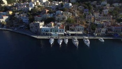 Flying over sailboats moored at the quay. Aerial view. Stock Footage