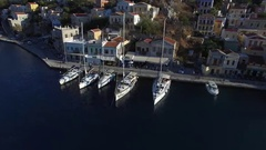 Flying over sailing boats are at the city pier. Aerial view. Stock Footage