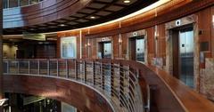 Cancer hospital man walks away balcony elevators DCI 4K Stock Footage