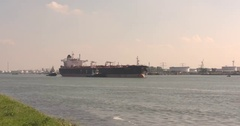 Oil tanker Propontis outbound on Calandkanaal, assisted by tugs Stock Footage