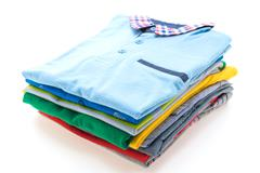 Stack of T Shirt and Polo Stock Photos