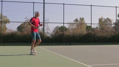 Teenager playing tennis fulfills supply Stock Footage