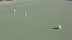 Tennis balls lay on the court in the summer Stock Footage