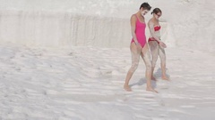Two girls tourists are taking smeared with clay beauty treatments spa Stock Footage