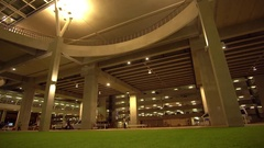 4K. Stream of traffic entering Phuket International Airport at night Stock Footage