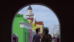 Tourists looking down colourful Bo Kaap street,Cape Town Stock Footage