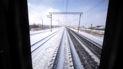 View from the back of the train through the window. Russia. Winter Stock Footage