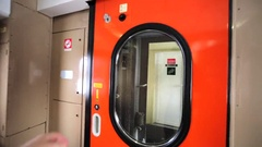 Openning the door in a compartment coach, moving through the vestibule Stock Footage