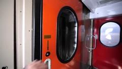 Entering a vestibule between train carriages. Stock Footage
