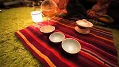 Tea ceremony: man is pouring tea three special teabowls Stock Footage