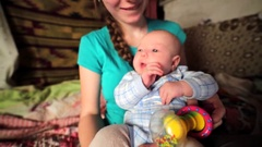 Wonderful newborn girl and her mother. The Chachzaevka Ecovillage. Stock Footage