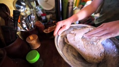 Woman is kneading the bread dough in flour in the bowl. Stock Footage