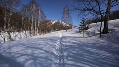 Walking along the snowy path in the Chachzaevka Ecovillage. Stock Footage