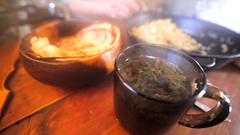 Closeup of hot aromatic herbal tea, and delicious pancakes in the bowl. Stock Footage