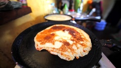 Close up view of pancakes cooking on the frying pan in the kitchen. Stock Footage