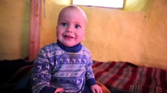 Little boy is smiling and looking in the camera. Stock Footage