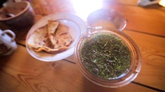 Closeup view of a steaming cup of delicious herbal tea Stock Footage