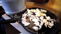 Closeup view of a frying pan with frying cutted onion. Stock Footage