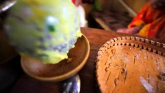 Putting pease porridge into a wooden bowl for breakfast. Stock Footage