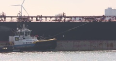 Oil tanker - side view - tug assist Stock Footage