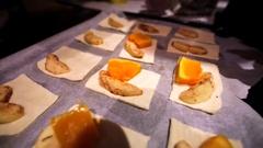 Putting cubes of baked pumpkin into a handmade dumplings, tasty rural dessert. Stock Footage